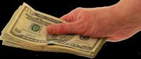 Money in hand - header image